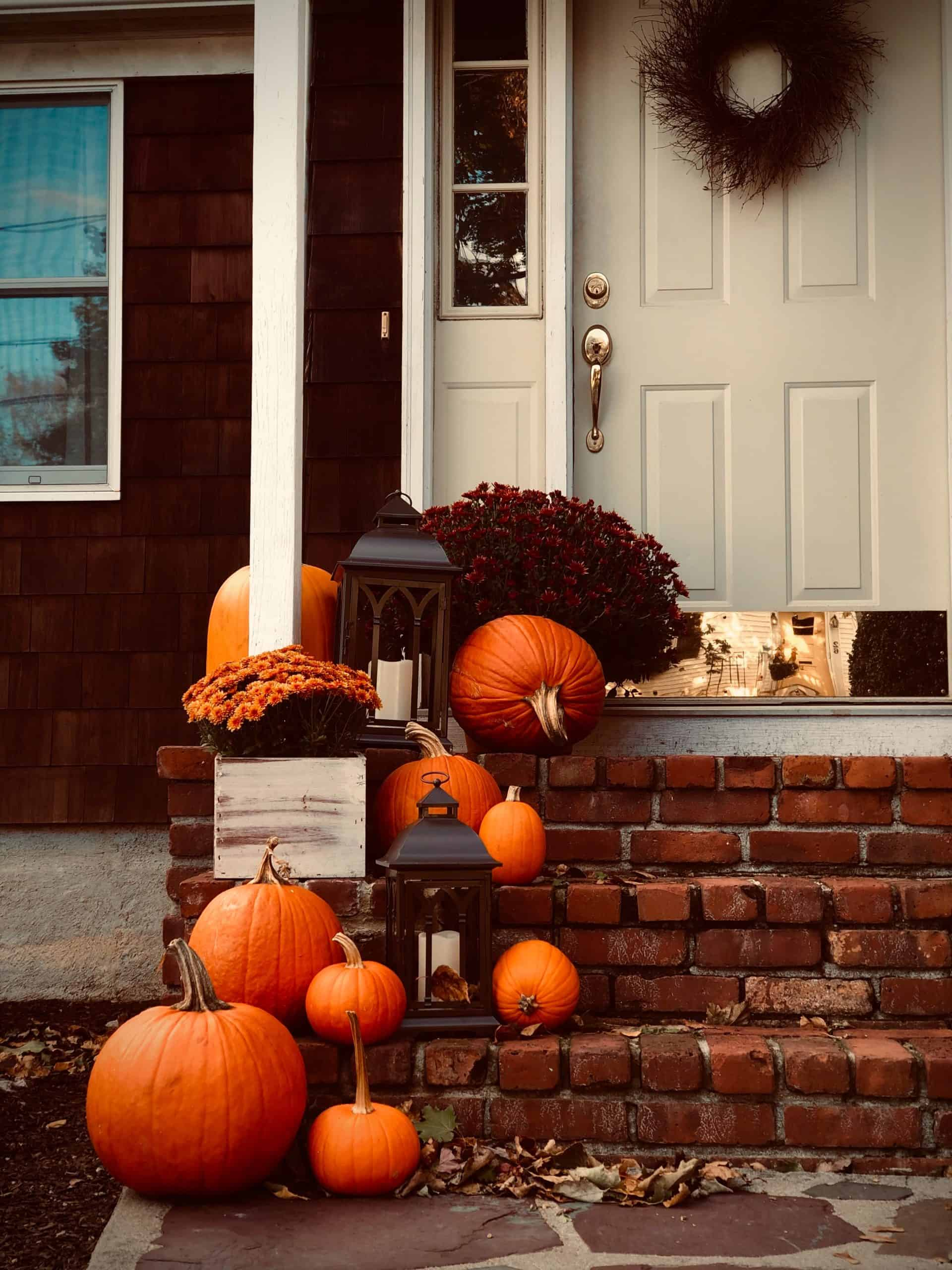pumpkins and lanterns on front porch